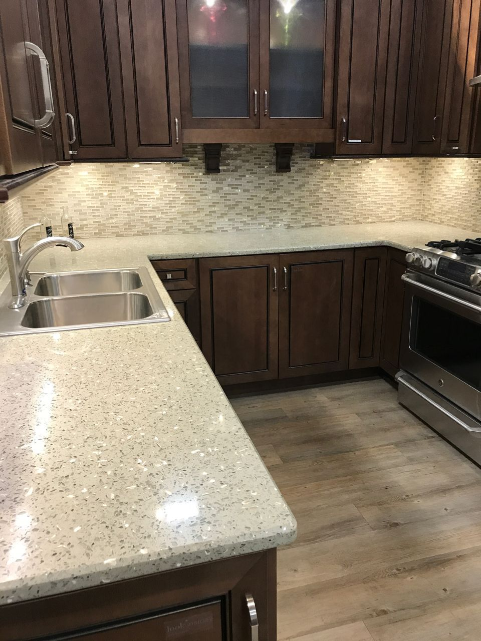 Our Musk Green Lemongrass Surface Was Designed With Seashells To Parallel The Wide Varieties Of Uses Glass Countertops Recycled Glass Countertops Glass Kitchen