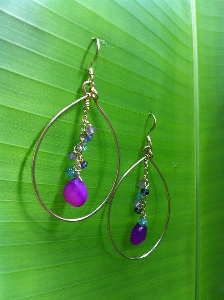 Noelani Designs: A bright combination of colors lets you shine!   Magenta chalcedony with semi-precious apatite, iolite, and amethyst within handmade hoop.