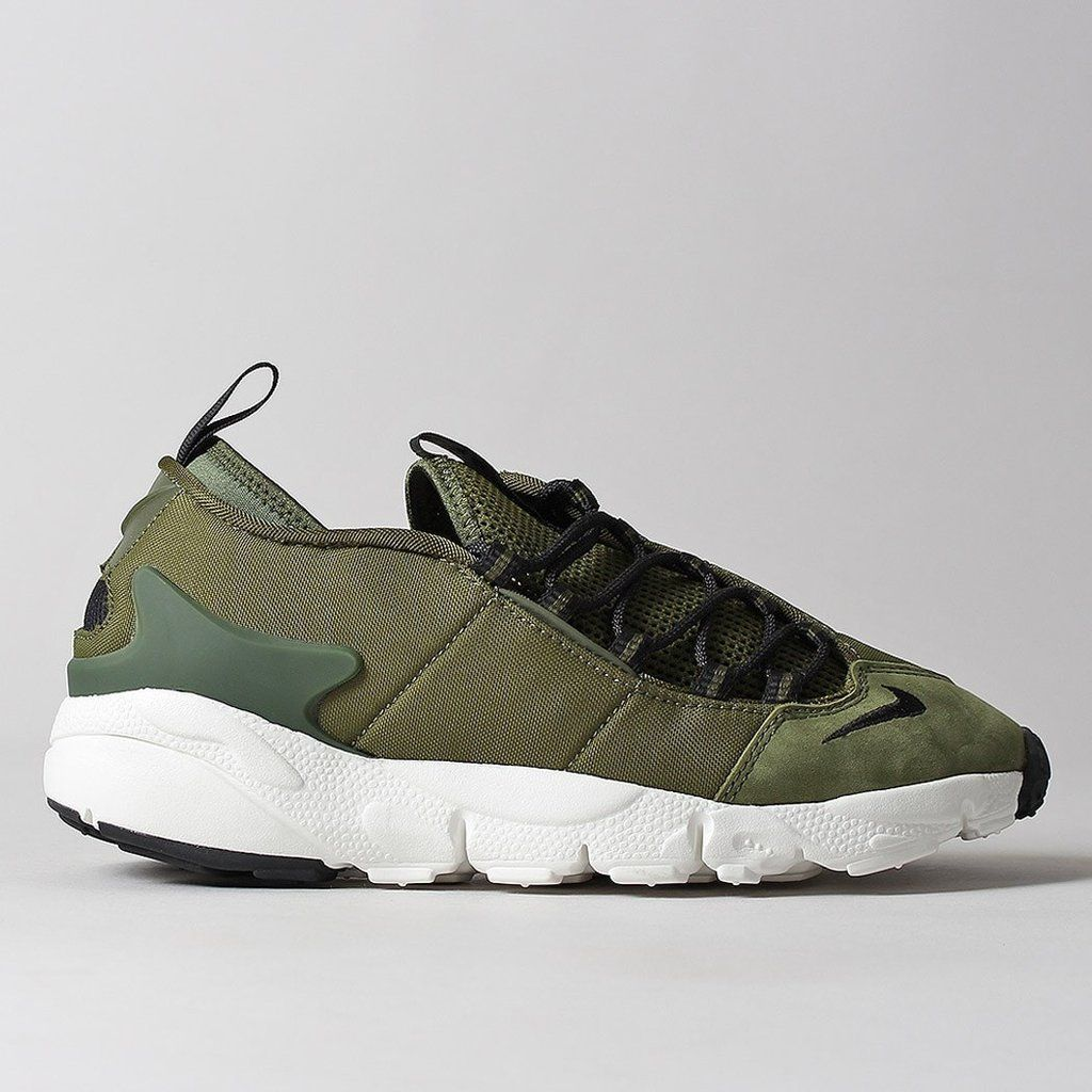 88b0992b2fdf Move naturally with the Nike Air Footscape NM Shoes in Legion Green Black  that remasters the 1995 style that focused on foot dynamics and flexibility.
