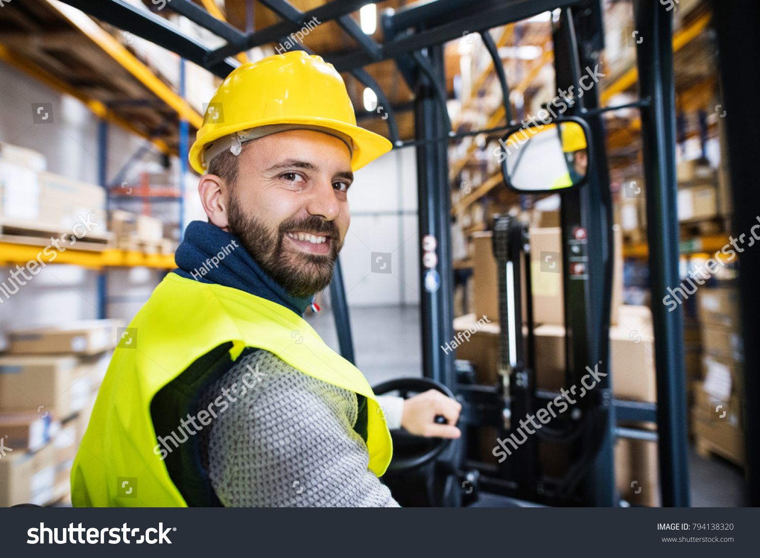 Warehouse man worker with forklift. Royalty Free image