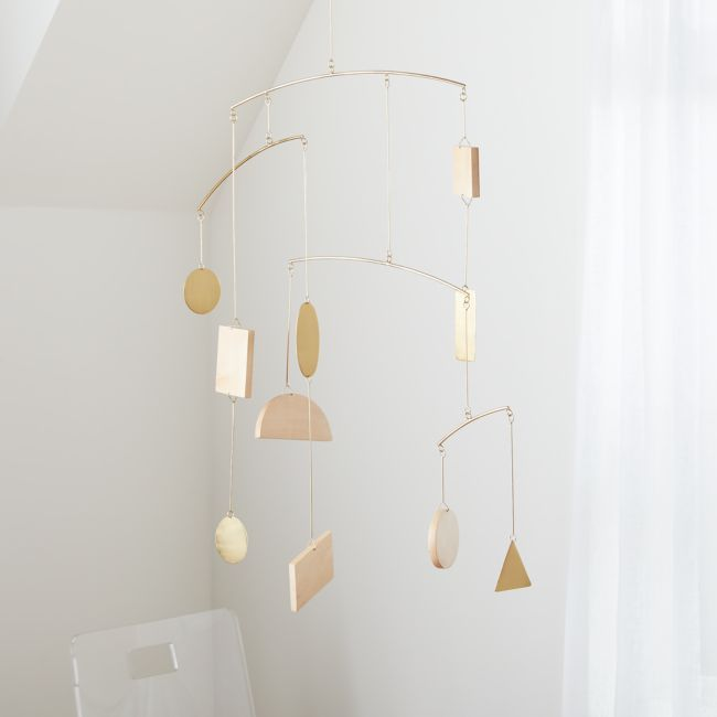 If you want a modern nursery, we suggest you keep our Simple Shapes Geometric Baby Mobile in the mix. With shapes made from natural maple wood and iron, this giftable, mixed material baby mobile was designed for on-trend nurseries. And don't go thinking it's all about fashion. While you'll love the mobile's look, we're pretty sure your little one will be completely dazzled by it.    Mixed material geometric baby mobile   Hanging hardware not included   Not to be used directly above baby's reach