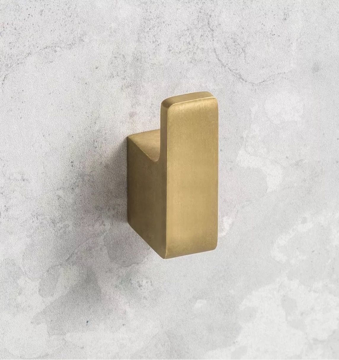 """Photo of Roger Seller Robe Hook in Burnished Brass. The perfect """"gold"""" tone."""