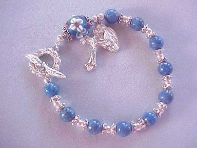 Rosary bracelet with denim lapis gemstone, lampworked glass, crucifix and medal dangles