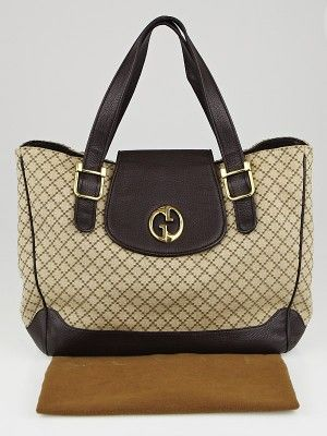 6edd3bdaea8be6 This gorgeous and current Gucci Beige/Ebony Diamante Canvas 1973 Medium Tote  Bag is the perfect everyday bag! The Gucci '1973' collection was inspired by  a ...