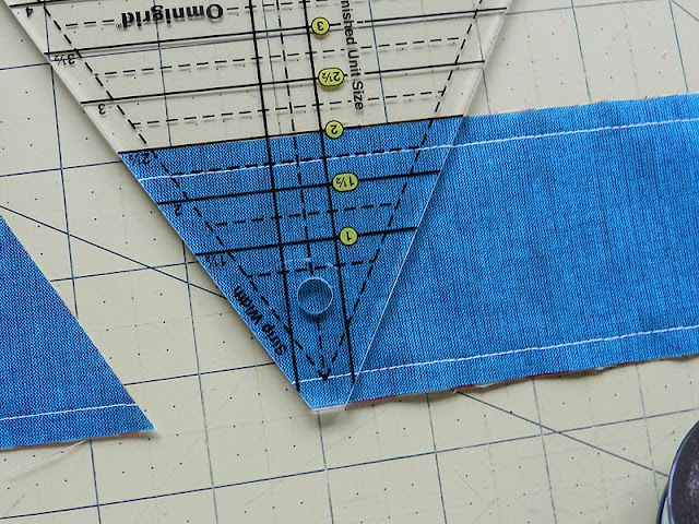 How to make a triangle quilt, quickly (tutorial by Molly Flanders). Oh how I wish I'd found these instructions before I'd cut out a bazillion individual triangles!