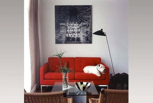 A-small-living-room-with-a-red-couch Interiors Pinterest