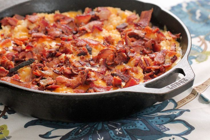 The star ingredients of this cheesy skillet dinner: bacon. Cheddar and shredded rotisserie chicken.