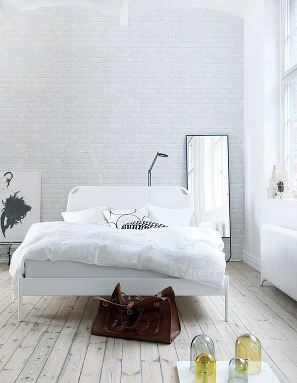 Nice white room white wooden floors everything is white with a goose down. Love this. Want this.