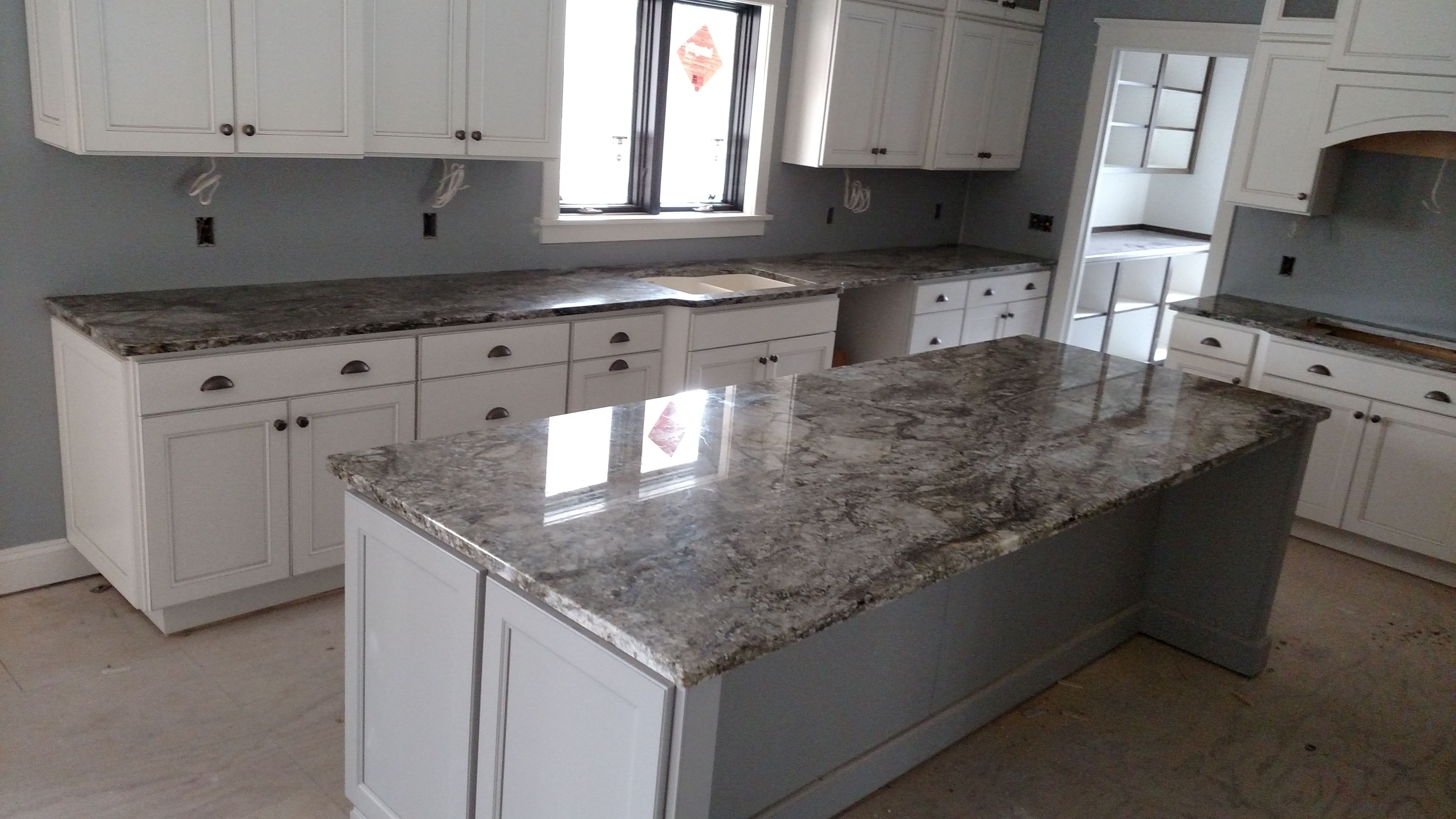 Smokey Mountain Granite Kitchen With White Cabinets