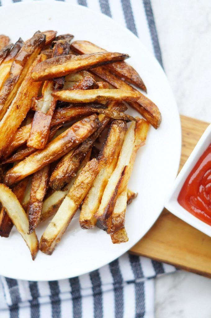 Making Homemade French Fries is easier than you think. These easy baked french fries are super crisp...