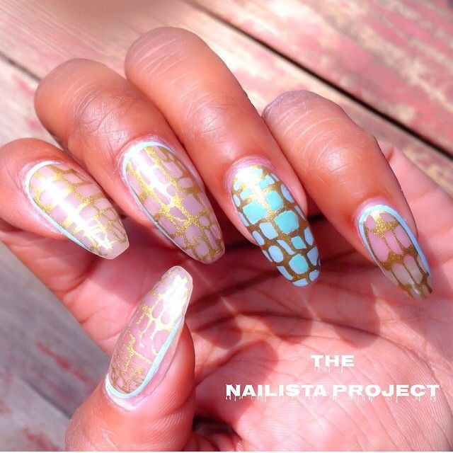 @thenailistaproject in our @chelseaqueen Reptilian #nailwraps. These gold and teal wraps look great alone or layered over nail polish.  www.goscratchit.com #goscratchit #scratch_reptilian