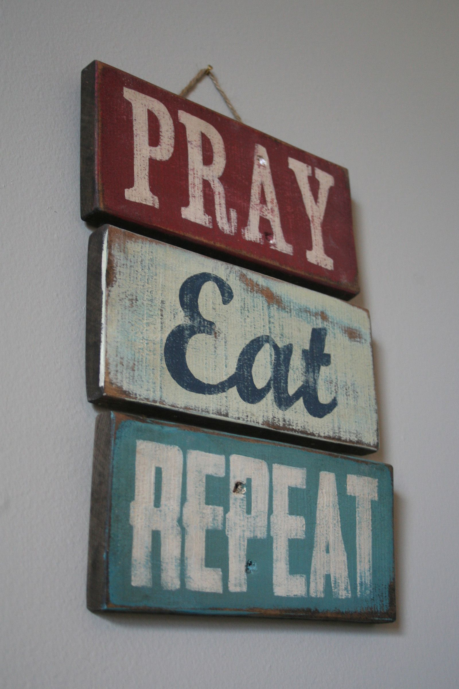 Pray-Eat-Repeat hand-painted pallet sign by Shanty Town Home Decor.