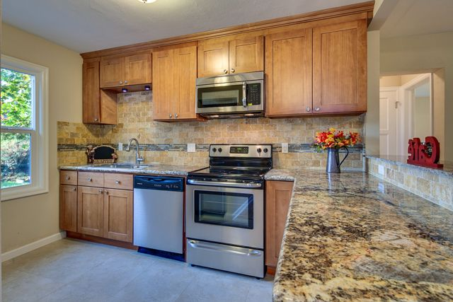 Who wouldn't want to move in this starter home in NE Portland, OR with a kitchen that looks like this?
