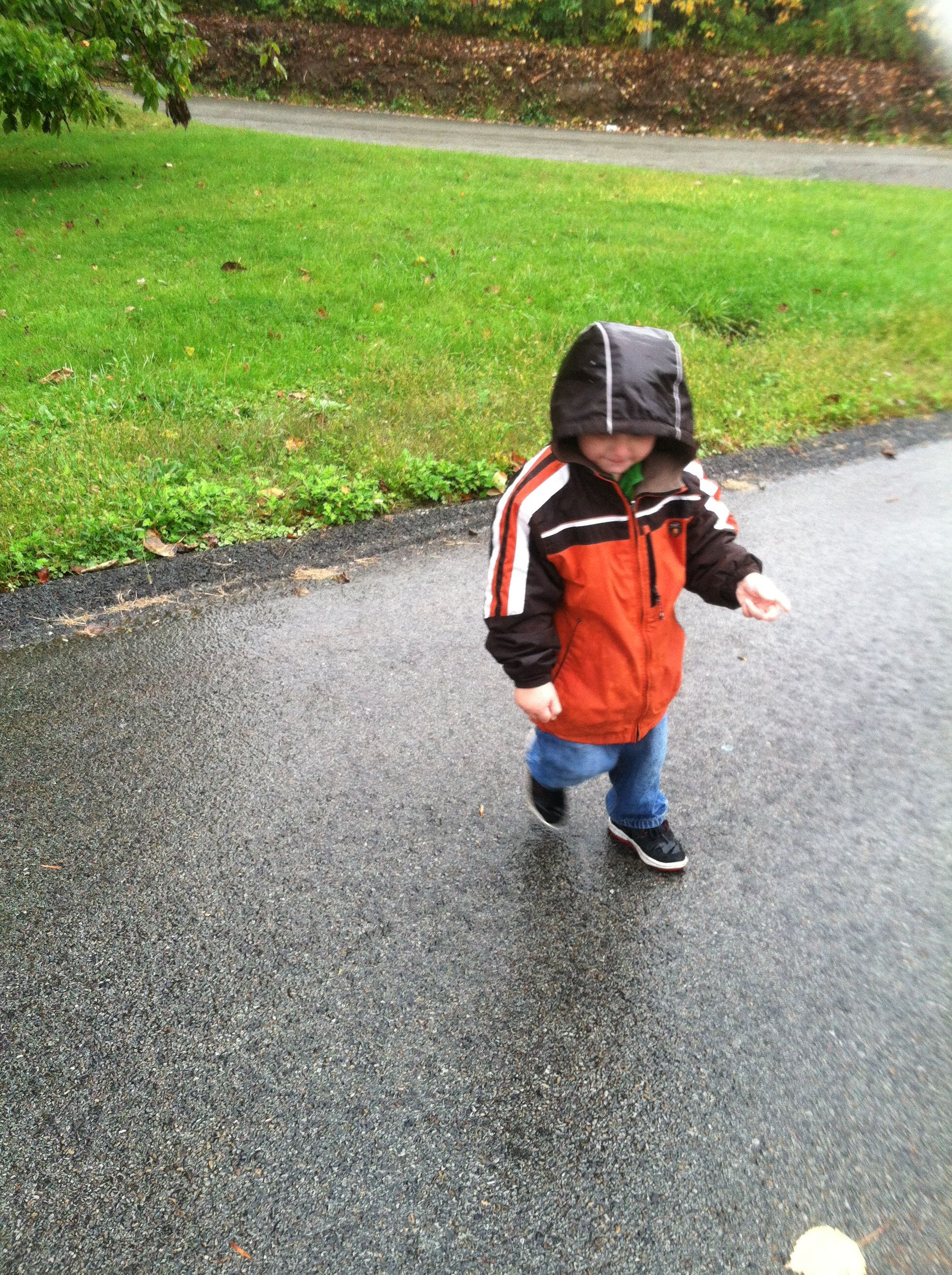 Zachary playing in the rain