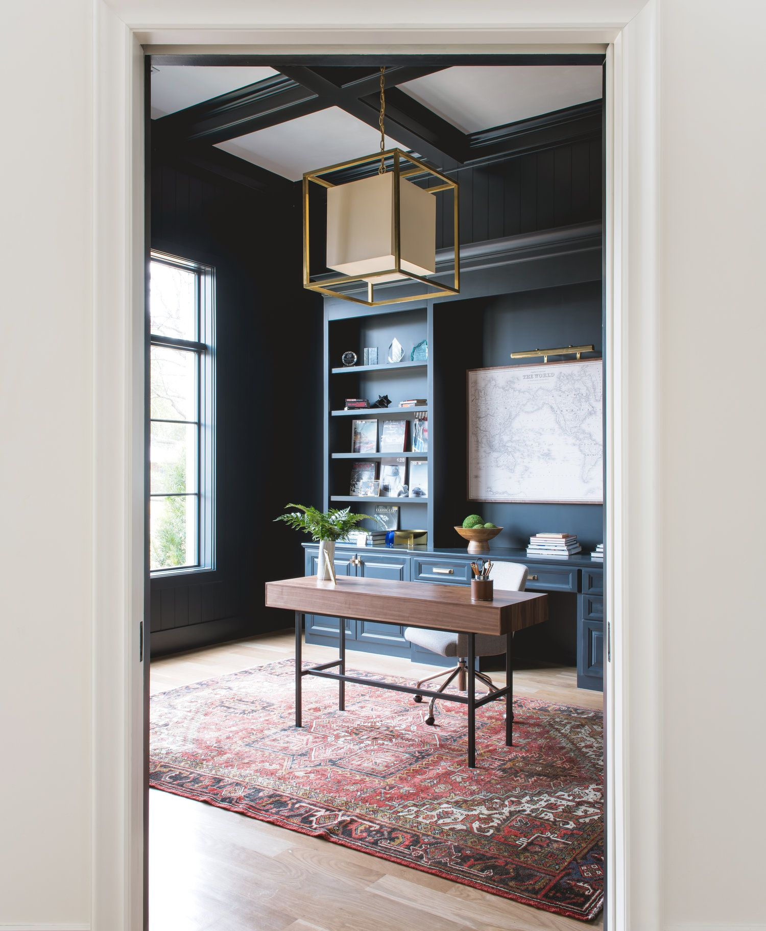 Home office + vintage rug + geometric lighting + coffered