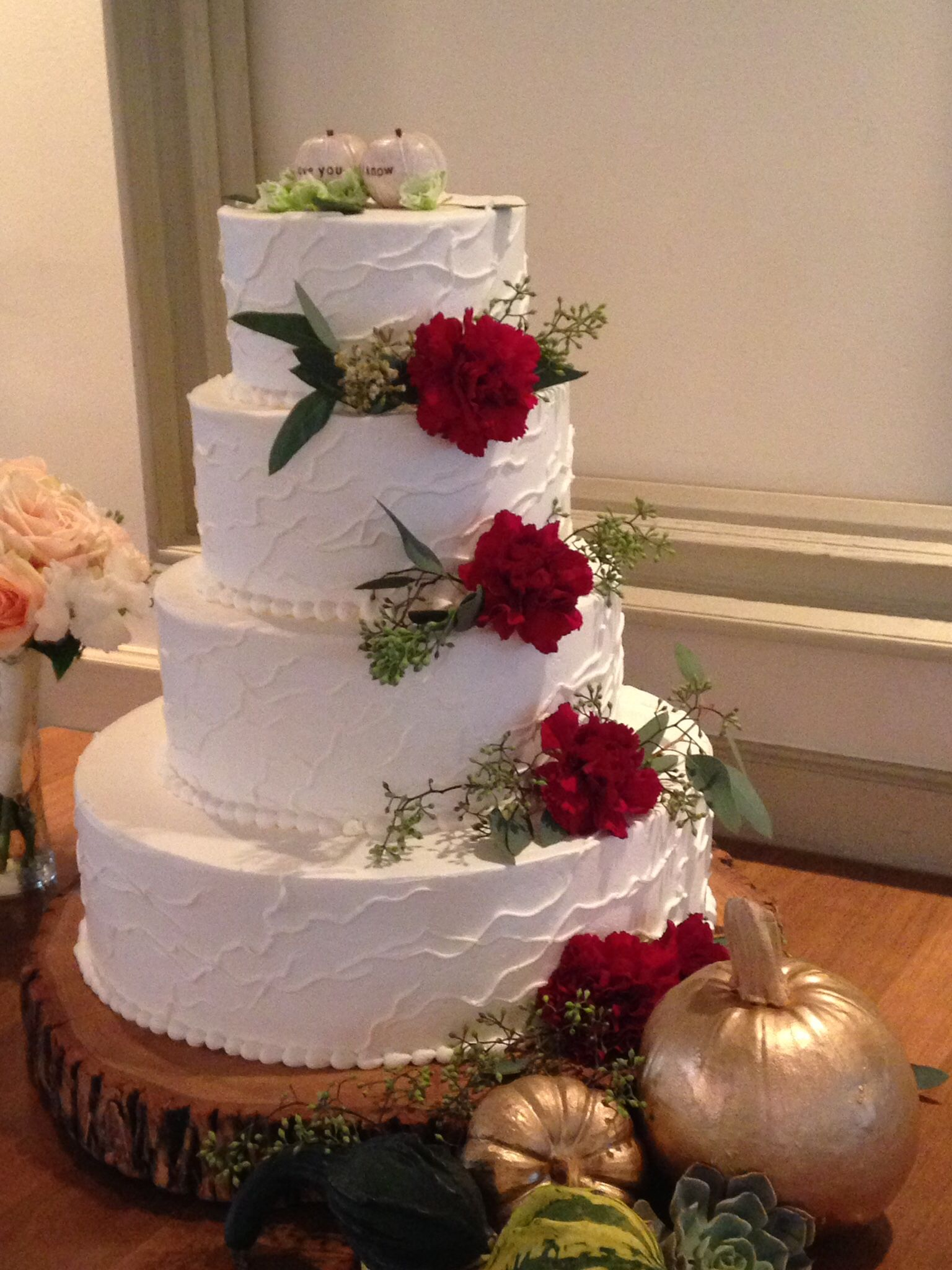 Fall wedding cake decorated with seeded eucalyptus and