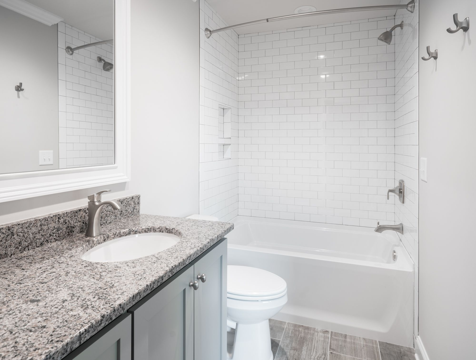 So great for a hall bathroom! Subway tile shower and tub, granite ...