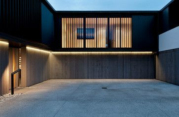 4 Modern New Zealand Homes Embrace Land And Sea Modern Garage Doors Garage Door Design Modern Garage