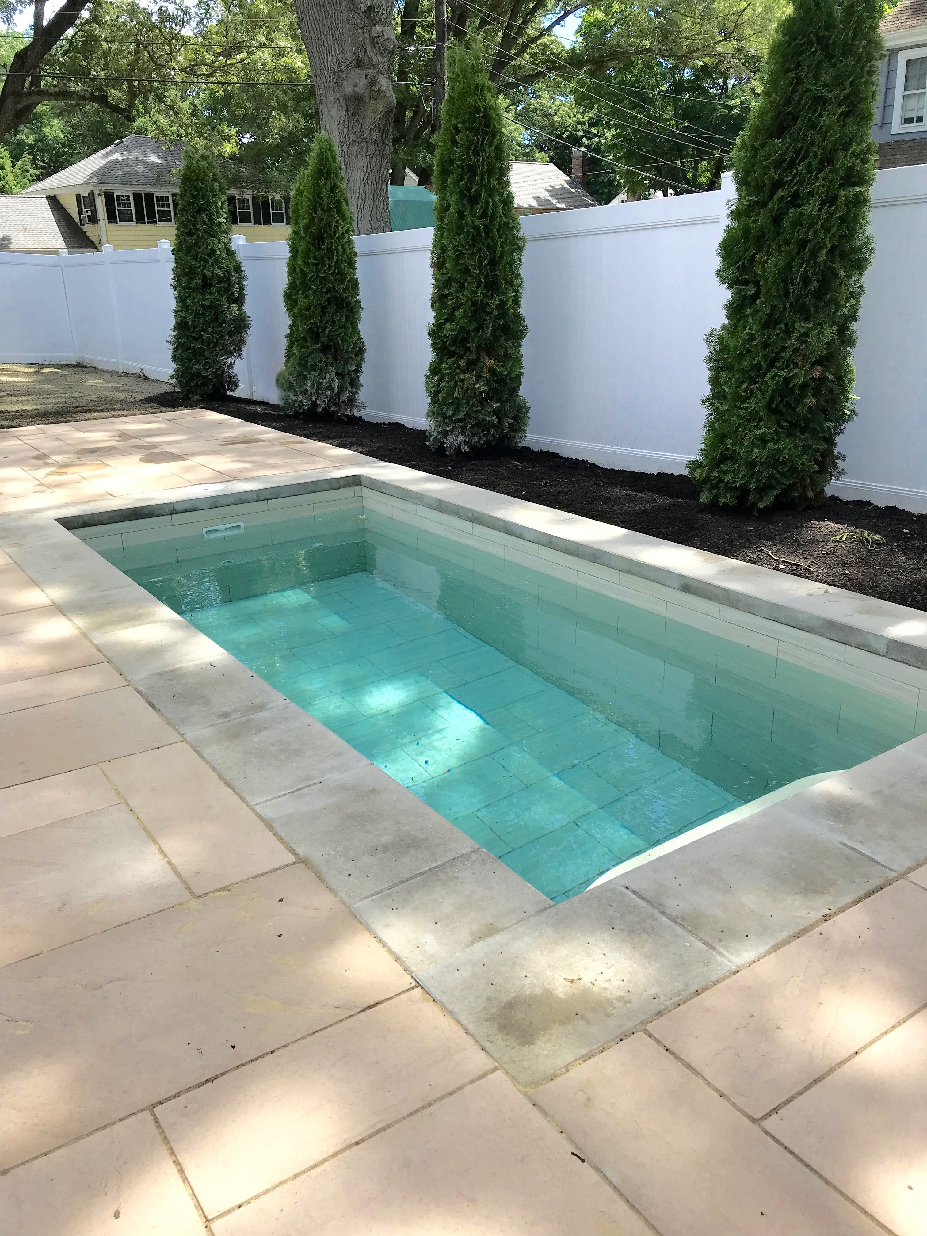 Flush Installation Of Ivory Soake Pool Perfect For Lounging Small Pool Design Small Pools Small Backyard Pools
