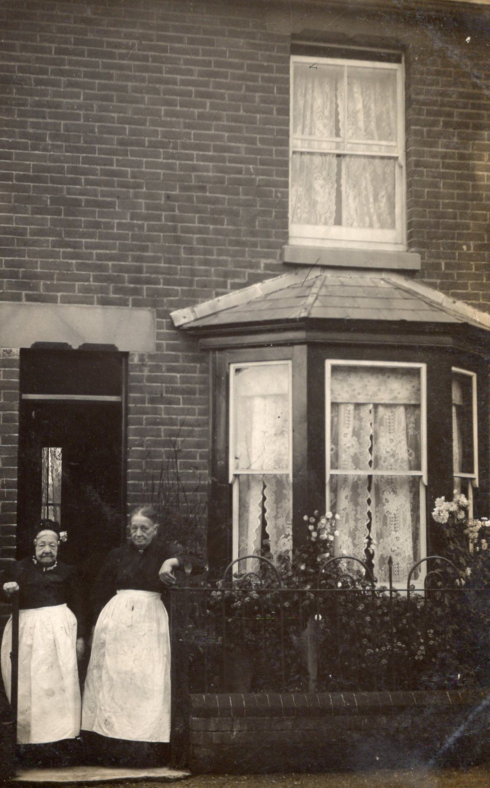 Old Photograph Elderly Couple At Gate Of House With Bay Window And Garden Flowers Victorian Homes Exterior Vintage Photos Vintage House