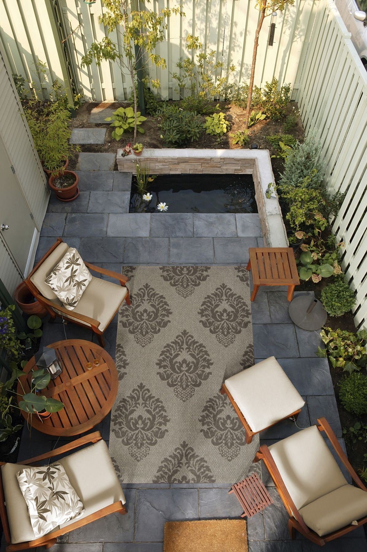 Small outdoor space brought to her by a Surya rug from the
