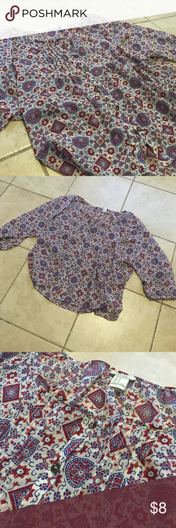 Forever 21 NWOT medium blouse NWOT / never worn cute printed forever 21 blouse! Nice smooth chiffon material & a size medium. Cute button / detail on front shown in photos. Forever 21 Tops Blouses