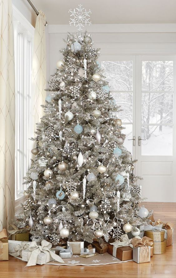 We love this silver and white Christmas tree frosted with snowflakes and hints of icy blue ornaments.