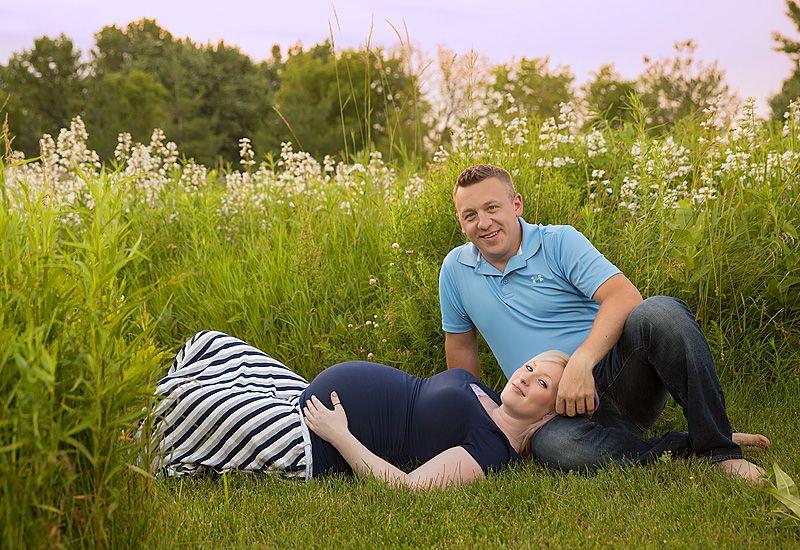 pregnant mother and partner in butterfly garden; Appleton