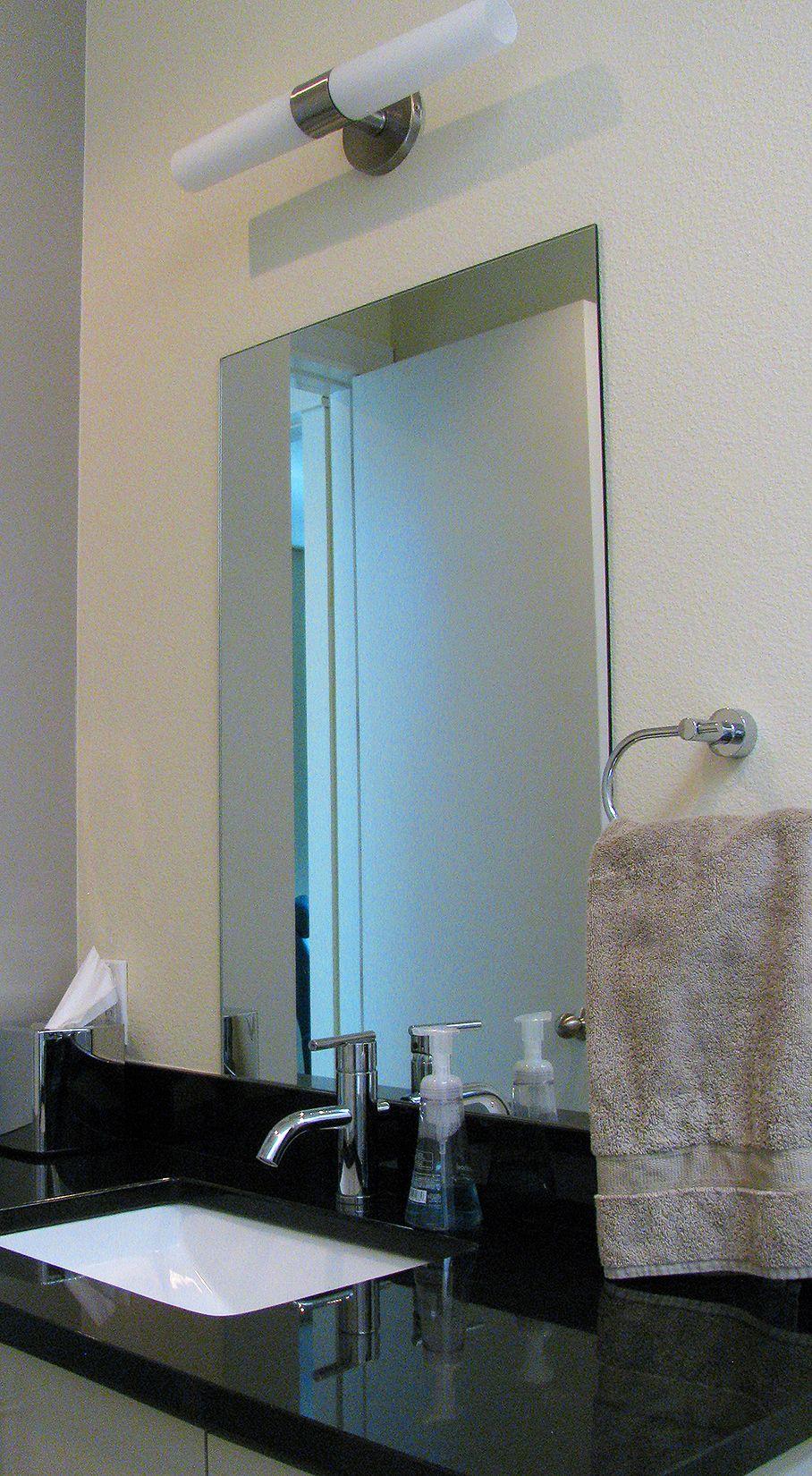 Front guest bathroom. Absolute Black granite countertop ...