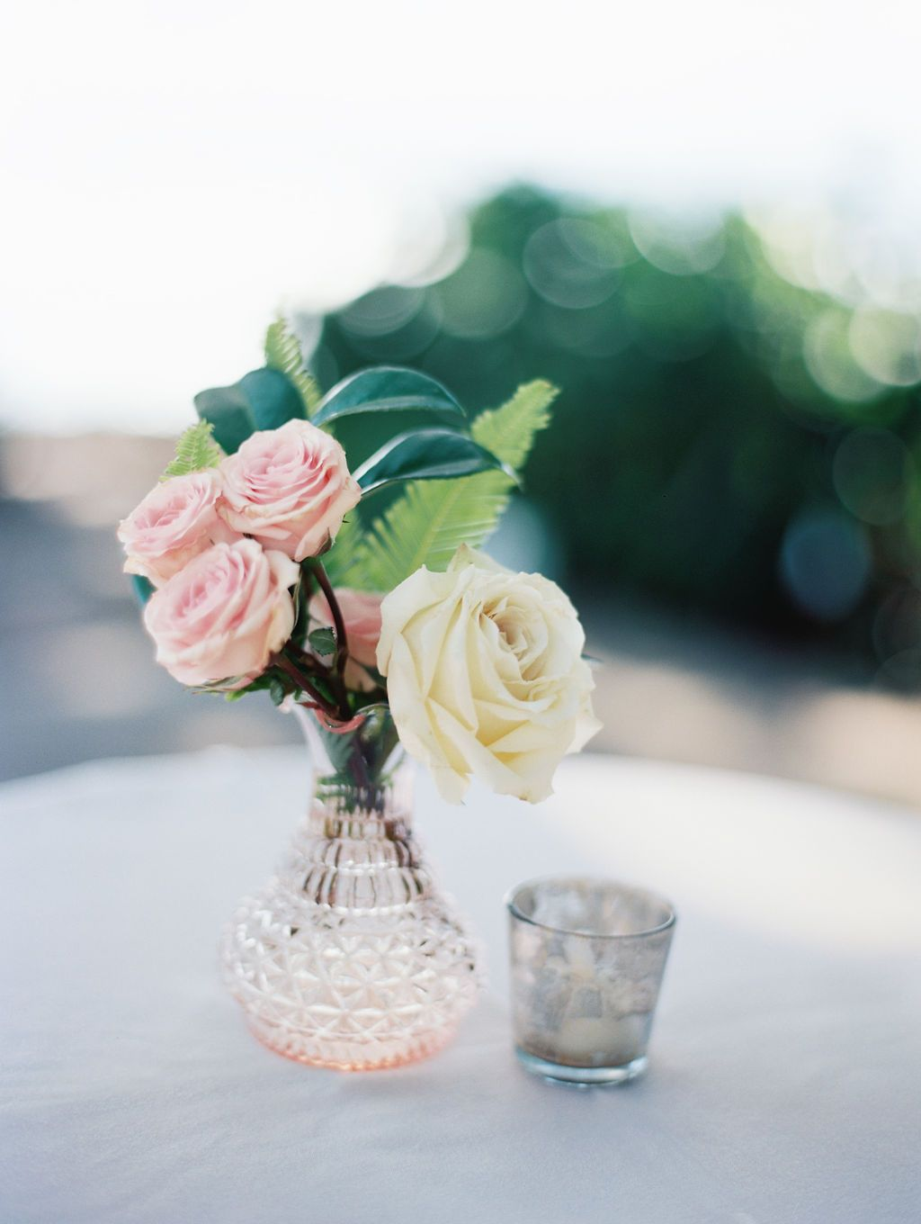 Highboy Cocktail Table with Petite Floral Arrangement in ...