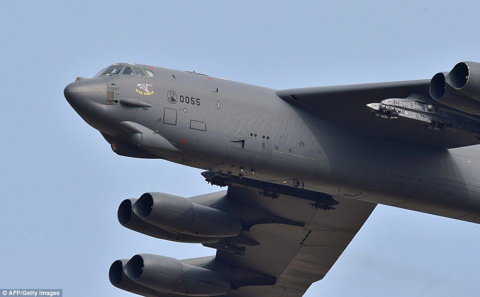 The B-52, pictured, first entered service in 1955 and can carry both nuclear and conventio...