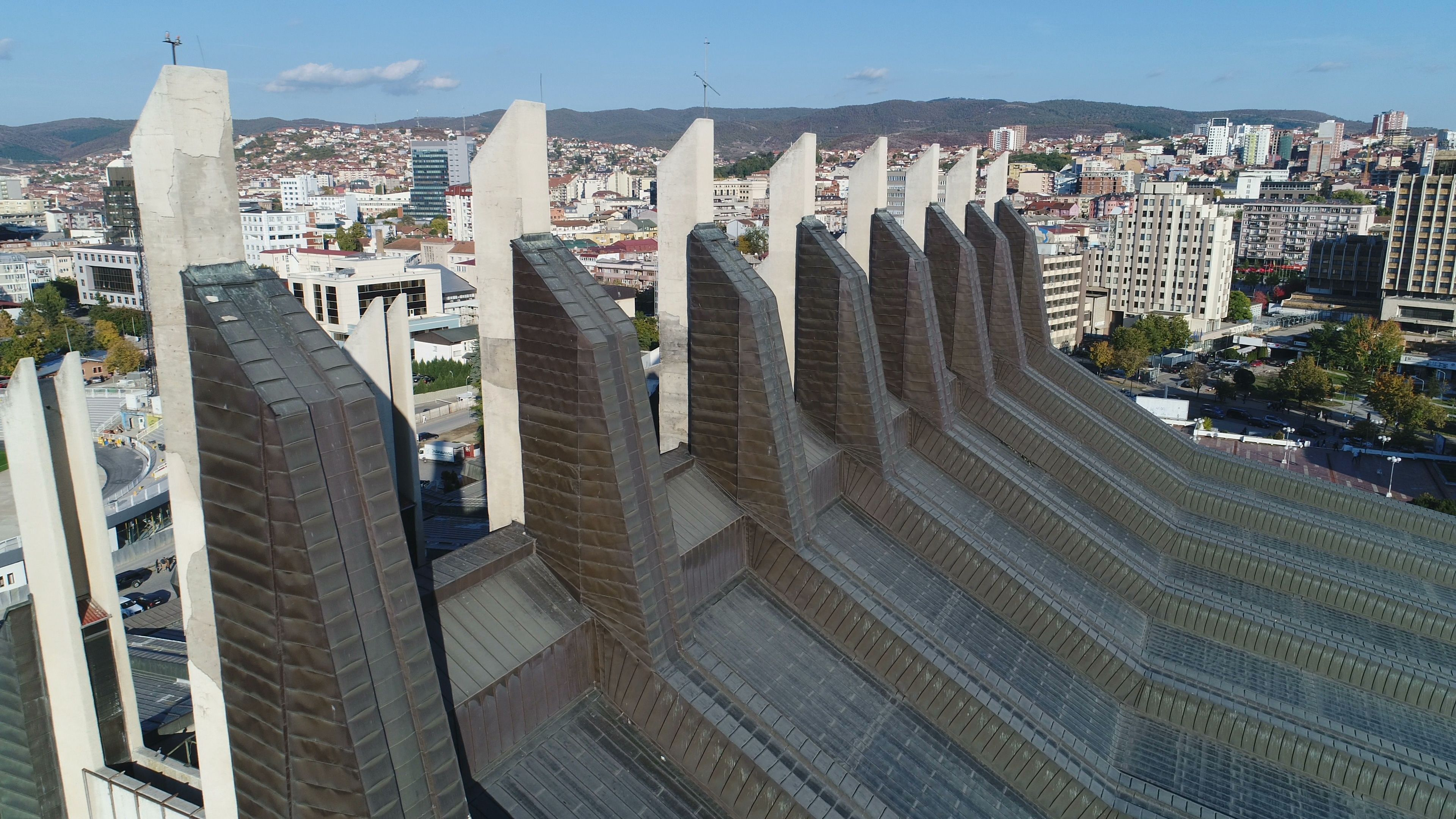 Drone shot sports center Pristina, Soviet era architecture