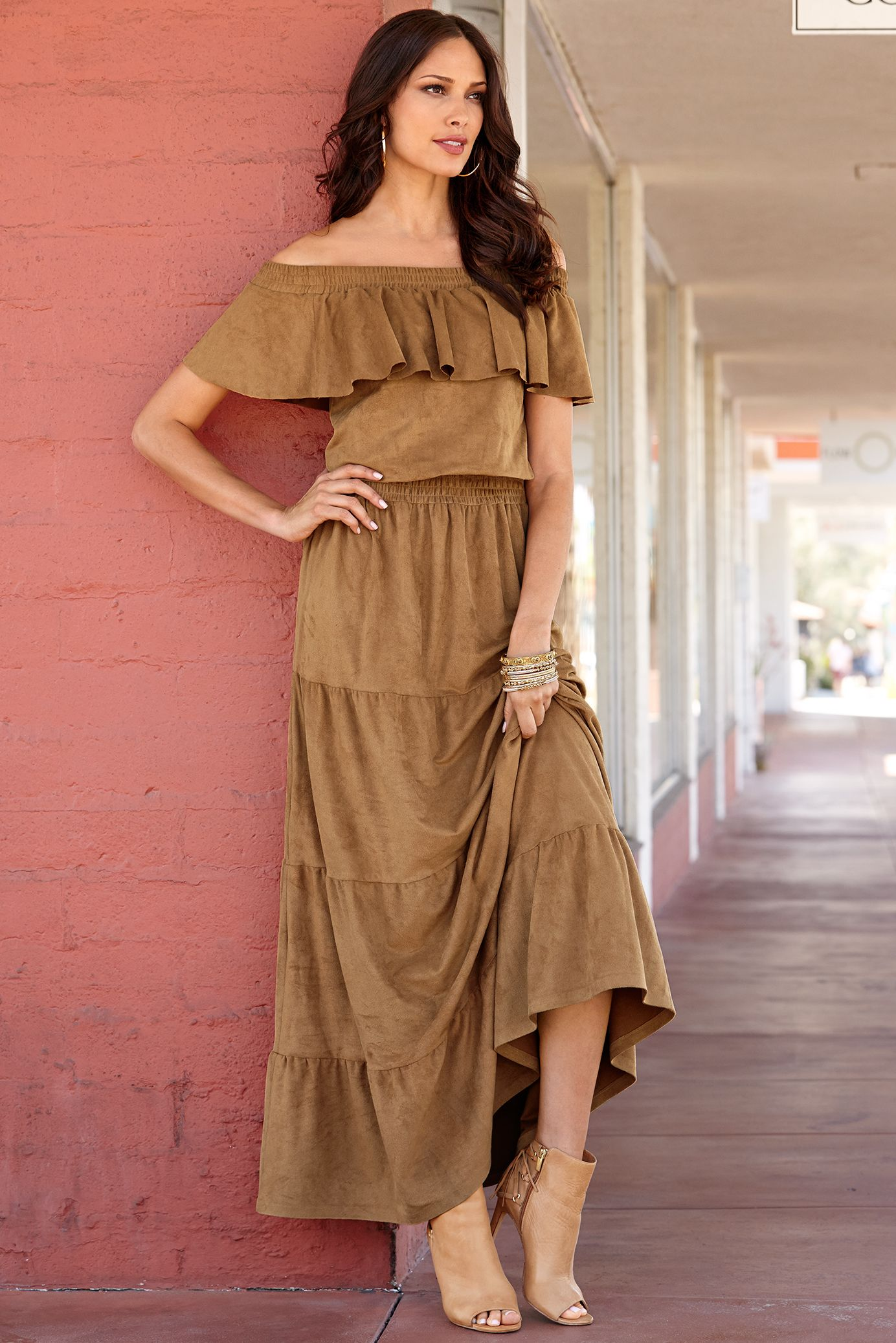 You are bohemian chic in our sensuous faux suede maxi dress with a ruffle overlay that accentuates the sexy smocked neckline and a tiered skirt that flows from a smocked waist.