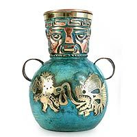 Copper and bronze vase, 'Inca Fishermen'. An ancient fisherman hauls a huge fish to shore while pelicans watch from the other side of the vase. By Ana María Enciso, this piece is steeped in Andean tradition and covered with gleaming Inca icons. Source: http://www.novica.com/itemdetail/index.cfm?pid=155039