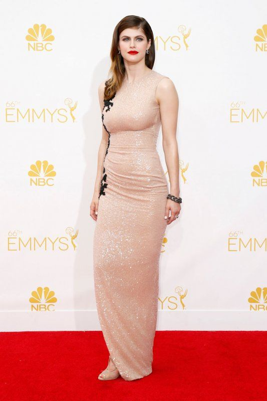 Alexandra Daddario in a nude embellished gown with black detailing.
