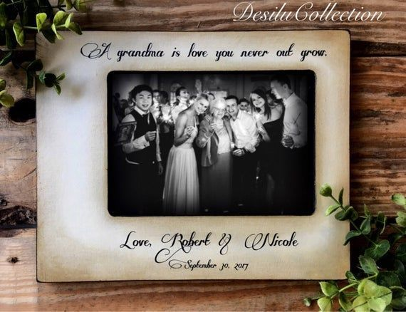 Grandparent Picture Frame Gift, Grandma,Grandpa,Wood Personalized Frame,Grandchildren,Grandkids, Gifts Mementoes, Wedding Gift for grandma #grandkidsphotography A grandma is love you never outgrow Personalized with name and date! Credit Photo Wedding photographer: Milosz at MMW Studio photography Hand crafted wood frame, 1 inch thick, Hand stained and painted, sealed to perfection. Each piece is unique and the rustic attributes to each frame are enhanced.  LEAVE ALL WORDING REQUESTS IN THE NOT #grandkidsphotography