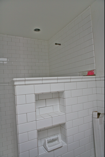 love the subway tile, the half wall, and these shelves