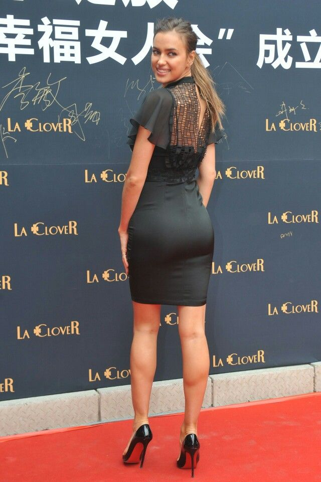 2b359a094b0 Irina Shayk booty and sexy legs in a curve hugging little black dress and  Louboutin high heels