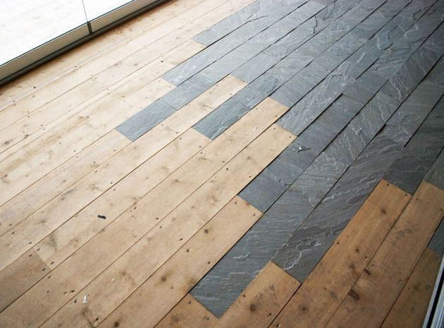 planks of stone are staggered against the hardwood