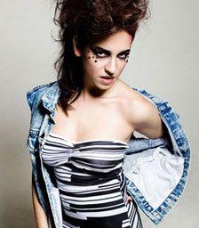 Yael rocks the diamante eye jewels...  Denim and Electric Bando a blisteringly hot look.