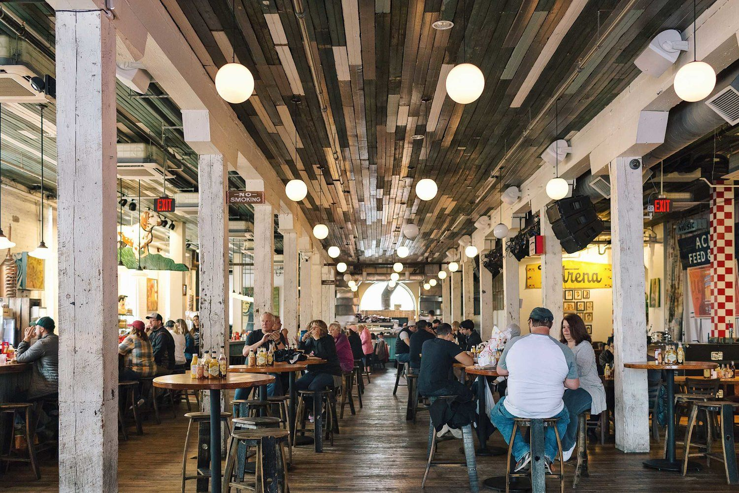 The First Floor Of Acme Feed Seed A Honkytonk Style Restaurant With Food And Beer To Be Eaten On Communal Tables