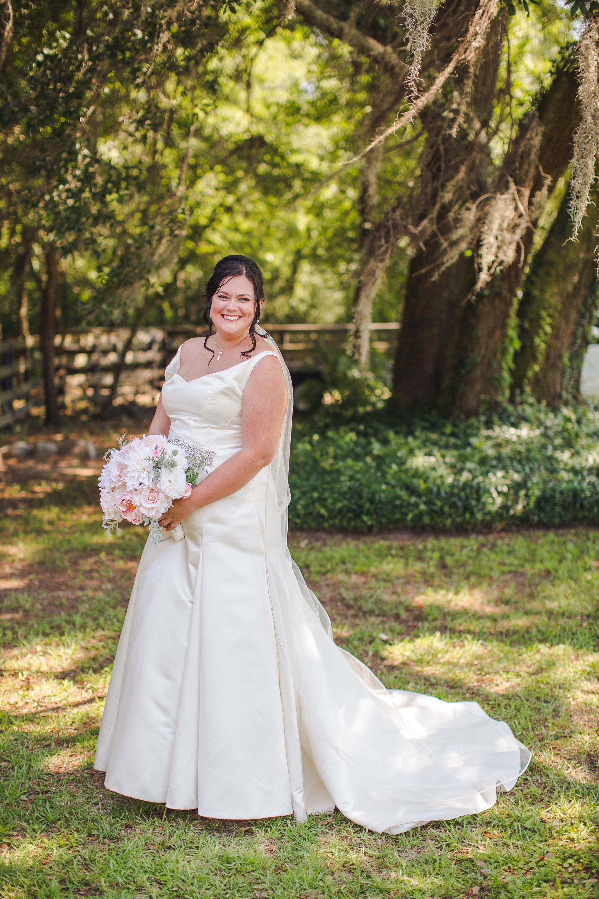 White satin, fit and flare wedding dress, chapel-length train, v-neck, bedazzled belt // Richard Bell Photography
