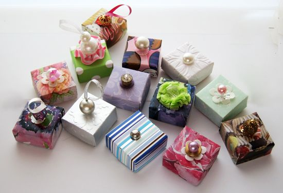 Petite gift boxes perfectly gift wrapped with snippets of paper and little embellishments.