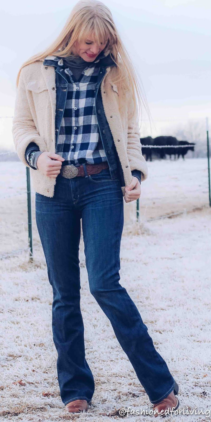Shearling Coat Layered Over Denim Jacket Outfit With Bootcut Jean And Cowboy Boots Bootcut Jeans Outfit Denim Jacket Winter Winter Outfits [ 1600 x 800 Pixel ]