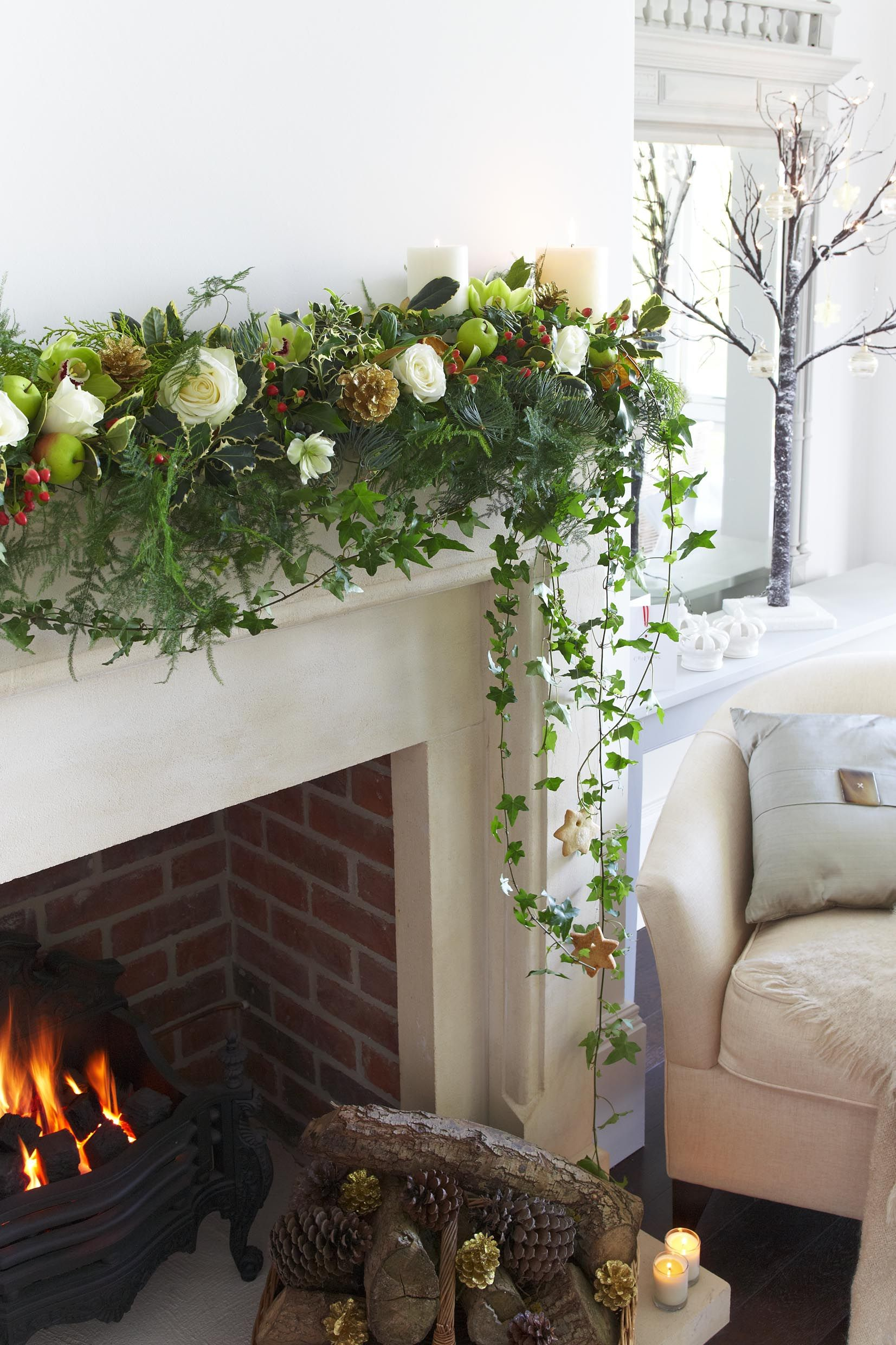 White rose, foilage and pinecone mantlepiece garland for