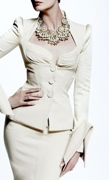 classy white suit with statement jewels
