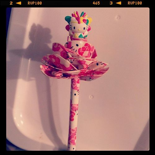 Hello Kitty duct tape pen with topper.