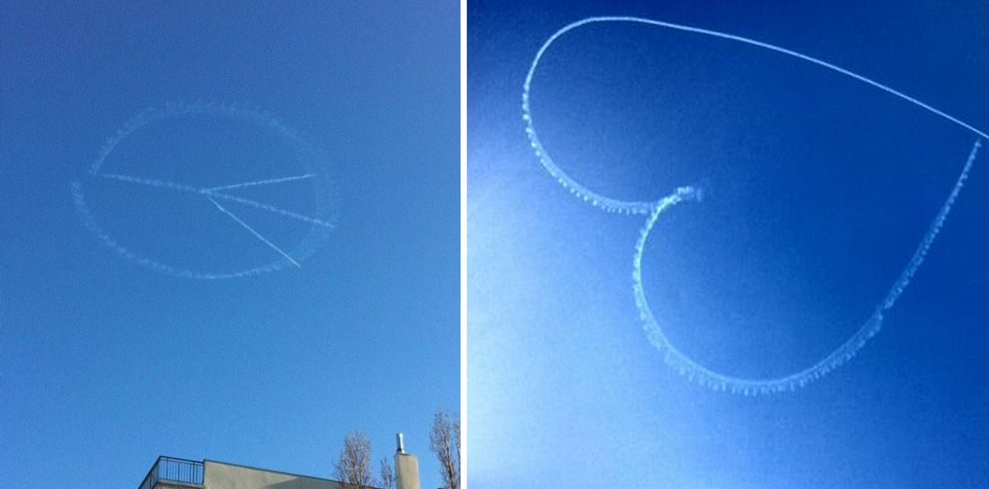 a lyon  un avion dessine des coeurs et des signes de paix