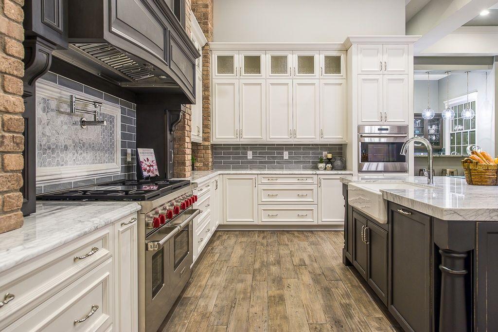 Traditional Kitchen with MS International Bianco Venatino Marble Slab Countertop, Flat panel cabinets, Kitchen island, Flush