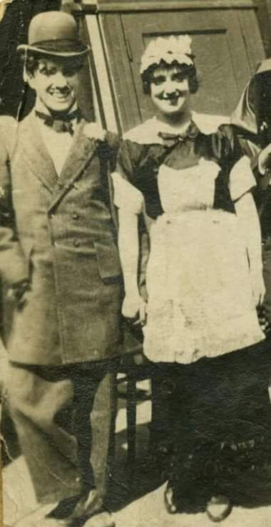 Rare candid photo of Chaplin and Mabel Normand during the filming of TILLIE'S PUNCTURED ROMANCE, 1914